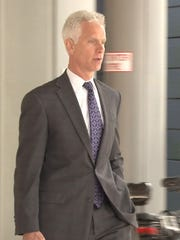 Attorney John Decker leaves the New Castle County Courthouse