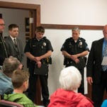 Port Clinton police Chief Rob Hickman (far right) recognized four law enforcement officers for their response to a Port Clinton woman who held officers at bay during a seven-hour standoff on April 6. Hickman presented Department Commendations to (left to right) Ottawa County Sheriff's Office Deputy Sgt. Kent Davis, PCPD Detective Ronald E. Timmons, PCPD Patrolman Ralph L. Edmonds and PCPD Sgt. Bruce Szilagyi at city council's r meeting Tuesday evening.