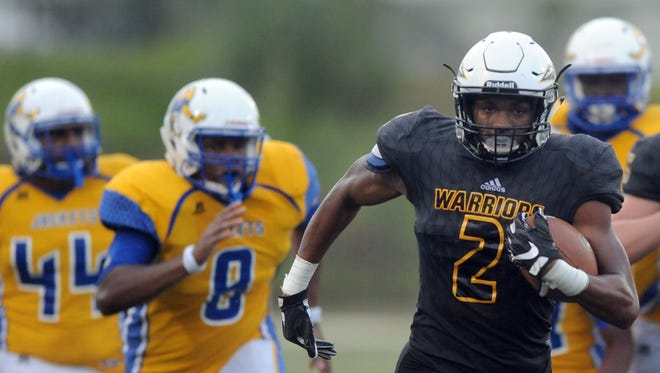 Oak Grove wide receiver Kevin Barnett runs the ball in a game against St. Martin on Friday at Oak Grove High School.