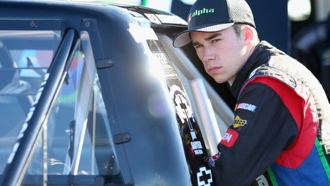 Ben Rhodes stands in the garage area during practice for the NASCAR Camping World Truck Series Lucas Oil 150 at Phoenix International Raceway on November 6, 2014 in Avondale, Arizona.