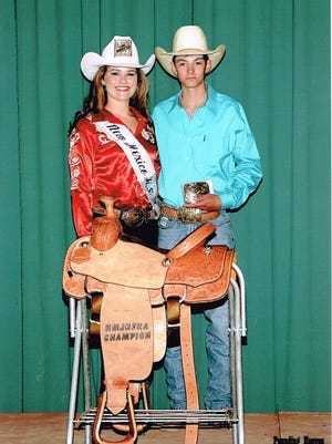 Tadd Dictson with his championship saddle, and buckle.