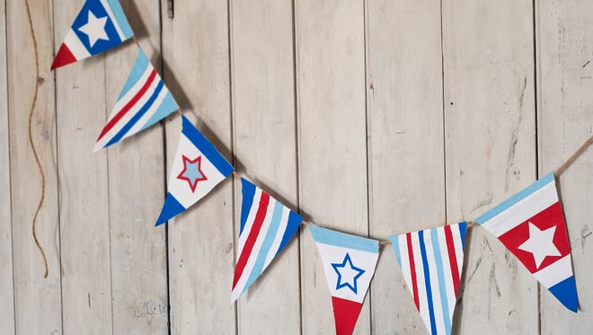 """An easy craft, Stars and Stripes Bunting, for Independence Day, adapted from Amanda Kingloff's book, """"Project Kid"""" (Artisan, 2014). The essential supplies include fabric or paper, freezer paper and acrylic paint."""