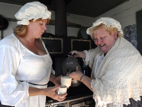 "Gretchen Mattingly, left, and Mary Eisenreich play ship cooks in a scene from the Heritage Players show ""Waterways"" in 2006."
