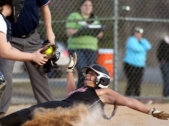 Hempfield's Aubrey Hartman (8) slides in for the score as Manheim Twp. catcher Alyssa Perkins (20) is late with the tag during 5th inning action at Hempfield High School Monday April 6, 2015. Chris Knight - GametimePa.com