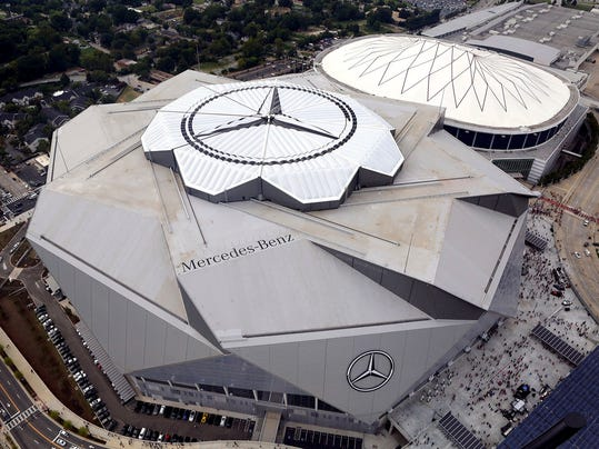 The new Mercedes-Benz Stadium, foreground, stands next to the Georgia Dome in aerial photo before an NFL preseason football game between the Atlanta Falcons and the Arizona Cardinals, Saturday, Aug. 26, 2017, in Atlanta. (Akili-Casundria Ramsess/Atlanta Journal & Constitution via AP)