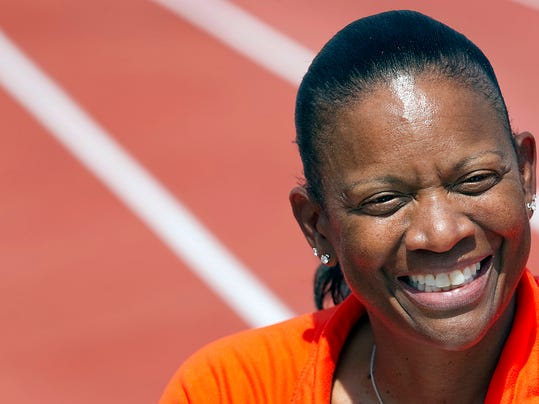 FILE-In this file photo taken March 31, 2011, Texas women's head track and field coach Beverly Kearney is photographed during practice in Austin, Texas. A former University of Texas president, former athletic director and former football coach Mack Brown all are scheduled to be questioned under oath next week in a sex and race discrimination lawsuit filed by former Kearney, who was forced out after the school learned she had a romantic relationship with one of her athletes a decade earlier. Kearney's attorneys have identified former President Bill Powers and former athletic director DeLoss Dodds and Brown as key figures in how the school reacted to Kearney's relationship and how its disciplinary response differed from actions taken against former football assistant Major Applewhite, who was allowed to stay on the job and later promoted despite a relationship with a student trainer on a team bowl game trip after the 2008 season. (AP Photo/Statesman.com, Ralph Barrera, file)