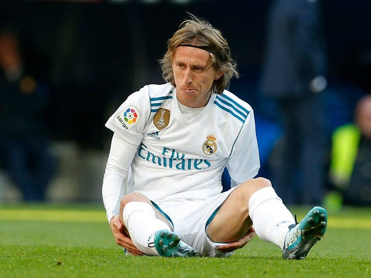 In this photo taken on Dec. 23, 2017, Real Madrid's Luka Modric sits on the pitch after falling during the Spanish La Liga soccer match between Real Madrid and Barcelona at the Santiago Bernabeu stadium in Madrid, Spain. Croatia midfielder Luka Modric has appeared in court in a tax fraud case in Madrid on Tuesday Jan. 9, 2018, accused of defrauding tax authorities of 870,728 euros (about 1 million dollars) in 2013 and 2014. Local newspaper El Mundo said Modric has already paid nearly 1 million (1.2 million dollars) to tax authorities to try to reach a settlement. (AP Photo/Paul White)