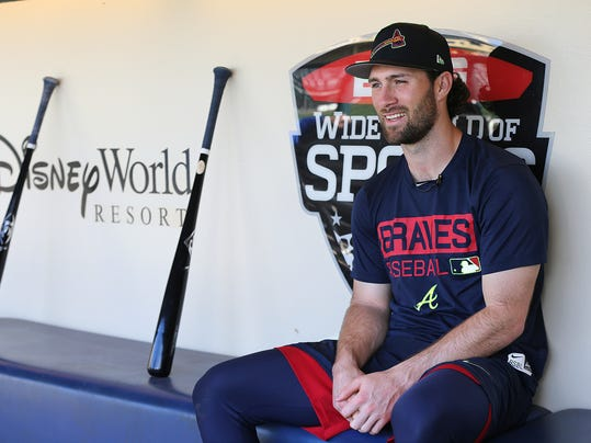 Atlanta Braves infielder Charlie Culberson sits in the dugout with his bats before starting team practice during baseball spring training, Wednesday, Feb. 21, 2018 in Lake Buena Vista, Fla. (Curtis Compton/Atlanta Journal-Constitution via AP)