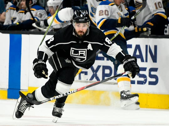FILE - In this March 10, 2018, file photo, Los Angeles Kings defenseman Drew Doughty (8) brings the puck up the ice against St. Louis Blues during an NHL hockey game in Los Angeles. Through the first two days of the Stanley Cup playoffs, there have already been a handful of hits to the head, two ejections, one suspension and the possibility of more to come. Kings defenseman Drew Doughty is already out a game for a shoulder to the head and Maple Leafs center Nazem Kadri and Capitals winger Tom Wilson could also face further discipline in a rough start to the NHL postseason. (AP Photo/John McCoy, File)