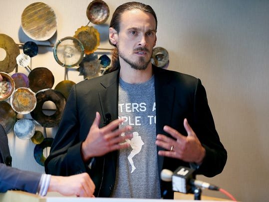 FILE - In this July 15, 2014, file photo, former Minnesota Vikings punter Chris Kluwe, right, speaks during a press conference in Minneapolis. Kluwe says he's reached a settlement with the team to avert a threatened lawsuit over his release. Kluwe had accused the Vikings of cutting him over his activism on gay rights issues. He said Tuesday, Aug. 19, 2014, that the Vikings have agreed to donate to several nonprofits to help raise awareness in professional sports about LGBT issues.  (AP Photo/The Star Tribune, Elizabeth Flores, File )  MANDATORY CREDIT; ST. PAUL PIONEER PRESS OUT; MAGS OUT; TWIN CITIES TV OUT