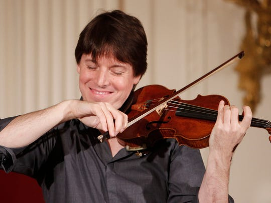 Violinist Joshua Bell performs at a Classical Music Student Workshop Concert hosted by first lady Michelle Obama in the East Room of the White House in 2009.