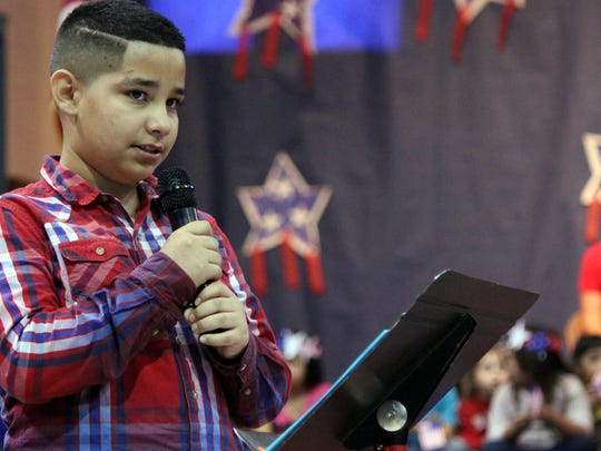 Issac Chavez delivers a speech in Spanish to the audience at the Veteran's Day Celebration at Ruben S. Torres Elementary School. Students sang patriotic songs and honored local veterans by hosting a free concert for the community.