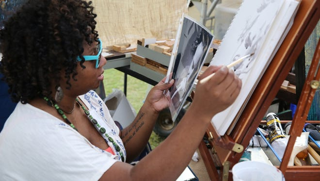 An artist demonstrates her craft at the Tennessee Craft Fair in September 2014.