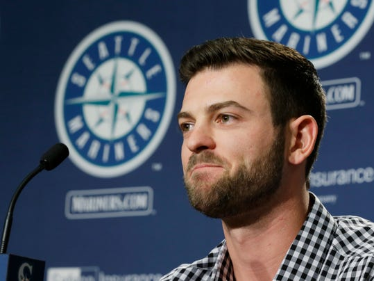 FILE - In this Jan. 26, 2017, file photo, Seattle Mariners outfielder Mitch Haniger talks to reporters during the teams annual pre-season briefing in Seattle. Some viewed young outfielder Mitch Haniger as a throw-in prospect in the offseason deal that got the Seattle Mariners a top-notch shortstop. The Mariners never felt that way. Not only did they want Jean Segura in their lineup, they expect Haniger to be their starting right fielder after only 34 major league games. (AP Photo/Ted S. Warren, File)