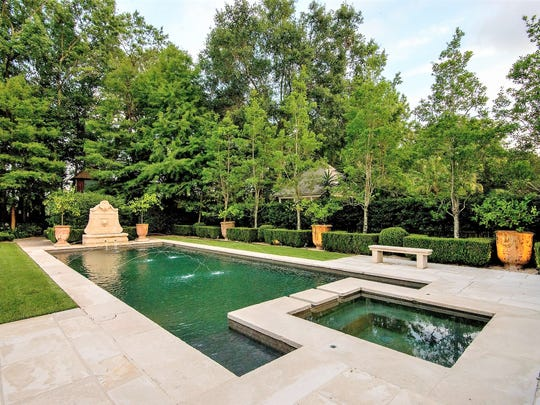 The beautiful pool is surrounded by manicured gardens.