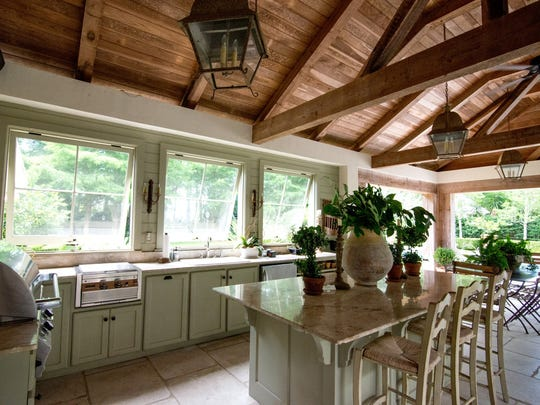 The huge outdoor living area includes a full kitchen.