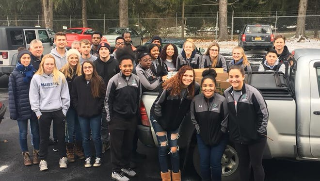 TC3 Student athletes and coaches in the parking lot of the Dryden Kitchen Cupboard after delivering more than 2000 cans of food and $500 to the work of feeding those in need.