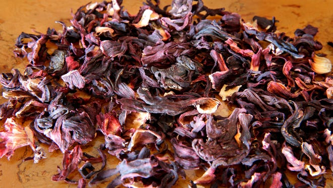 The dried flowers of a certain kind of hibiscus can be steeped or reconstituted to use in drinks, which they turn a vivid ruby red, or in dishes. The taste is tart, like cranberry.