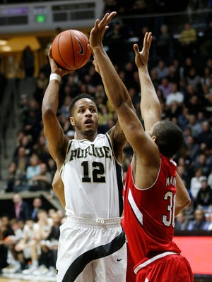 Vince Edwards with a pull up jump shot over Ed Morow of Nebraska Saturday, January 30, 2016, at Mackey Arena. Purdue defeated Nebraska 89-74.