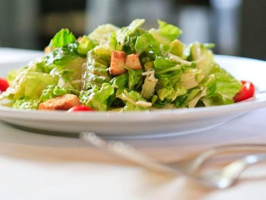 Vincenzo's Caesar salad features Romaine lettuce, herbed