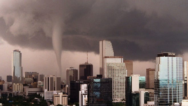 A tornado moves through downtown Miami on May 12, 1997, after touching down on the southwestern edge of the city.