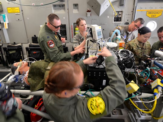 Air Force and Army edics stabilize a simulated patient