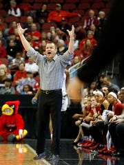 Louisville coach Jeff Walz reacts from the sideline. 