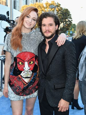 'Game of Thrones' cast members Sophie Turner and Kit Harington were among the many stars attending the Season 7 premiere screening Wednesday in Los Angeles.