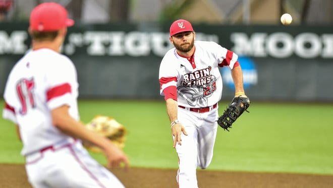 Second Baseman StefanTrosclair makes the quick toss to first to get the out as the Cajuns take on Nichols at The Tigue. April 19, 2016