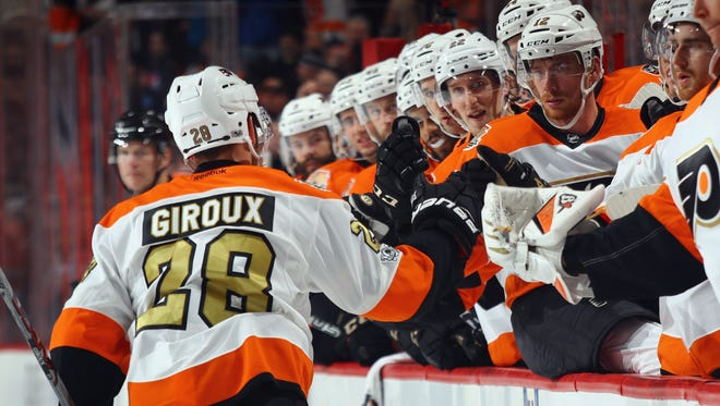 Claude Giroux and the Flyers need to pick up the offense and the pace to repeat last year's run to the playoffs.