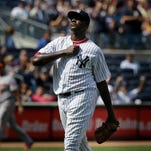New York Yankees starting pitcher Michael Pineda reacts after striking out Baltimore Orioles' Ryan Flaherty during the seventh inning of the baseball game at Yankee Stadium, Sunday, May 10, 2015, in New York.