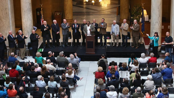 "The Rev. Carl Kelley, at podium, associate pastor at Phillips Temple CME Church in Indianapolis, is flanked by other members of the Indiana Pastors Alliance during a rally at the Statehouse on Monday, April 27, 2015, to protest the ""fix"" made to the Religious Freedom Restoration Act."