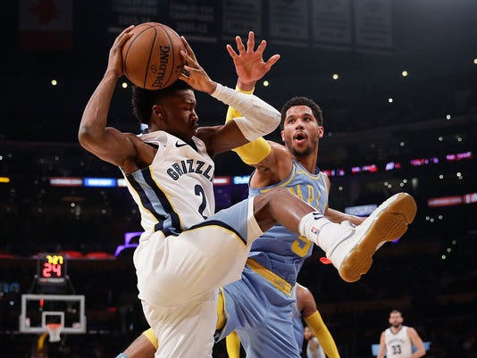 Memphis Grizzlies' Kobi Simmons, left, gets a rebound against Los Angeles Lakers' Josh Hart during the first half of an NBA basketball game Wednesday, Dec. 27, 2017, in Los Angeles. (AP Photo/Jae C. Hong)