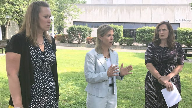 Attorney Christina Sonsire, center, criticizes the Steuben County District Attorney's Office on Tuesday following sentencing of Corning chiropractor Jeremiah Wright in City of Corning Court. Joining Sonsire are alleged abuse victims Stacey Brzezinski, left, and Wendi Hammond.