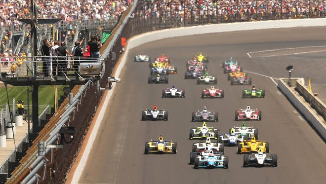 The green flag drops at the Indianapolis Motor Speedway for the start of the Indianapolis 500 on May 25.
