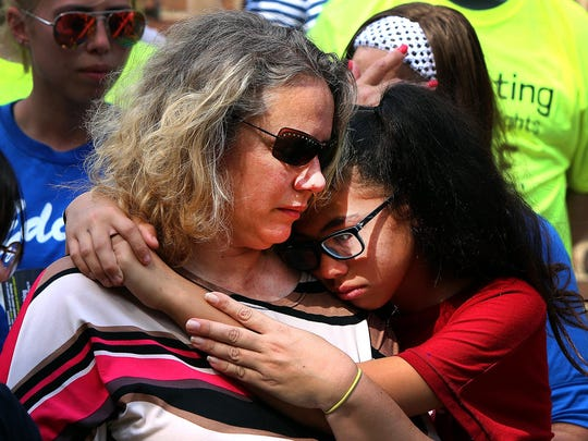 Brandi Davison-Edralin and her daughter Michelle Edralin at a rally in Highland Park on Friday in support of Davison Edralin's husband, Cloyd Edralin, a green card holder and 30-year U.S. resident who was detained by ICE officers while he was on his way to work on Monday.