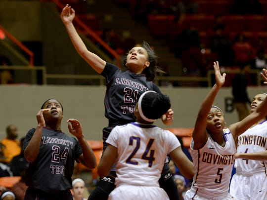 Liberty Tech's Aleysia Mason-Pavia goes up for a shot over Covington defenders during their game Thurssday.