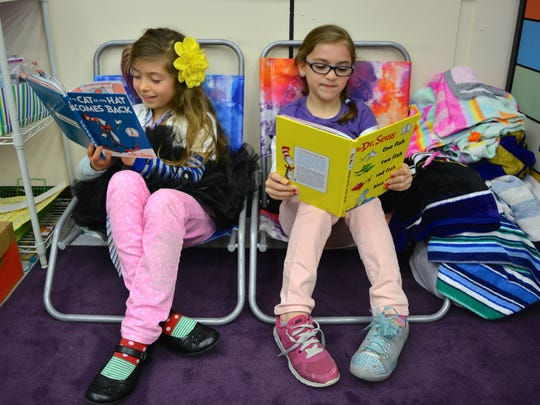 Second graders Savannah Wertz and Alicia Suarezapecheche read Dr. Seuss books in their classroom on Wednesday, March 2.