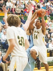CMR's Karl Tucker II leaps to score during the crosstown