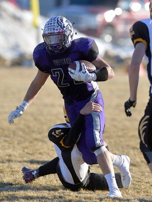 Valier's Trever VandenBos runs with the ball during a playoff game last season. VandenBos, along with Sunburst's Treyton Pickering and Shelby's Zach Torgerson have signed with Montana Tech.