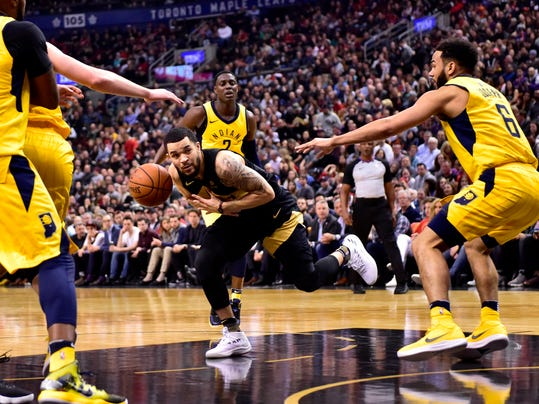 Toronto Raptors guard Fred VanVleet, center, is fouled by Indiana Pacers guard Cory Joseph, right, during first-half NBA basketball game action in Toronto, Friday, April 6, 2018. (Frank Gunn/The Canadian Press via AP)