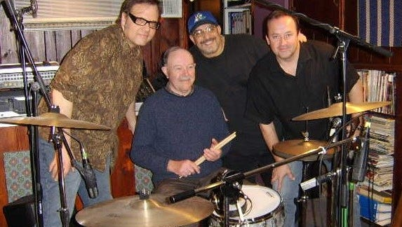 Drummer Andy White with members of the Smithereens.