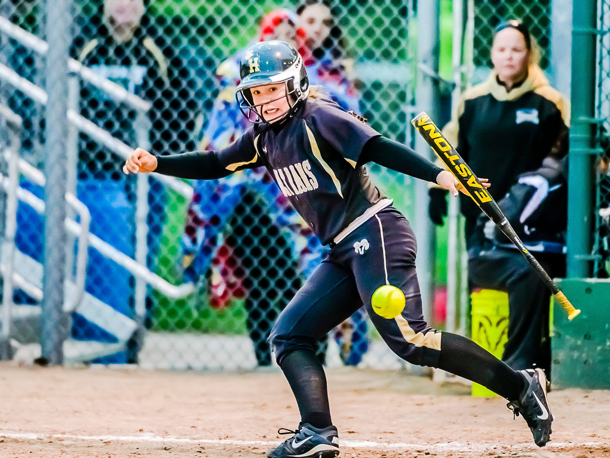 Tracee Hartley of Holt watches the ball as she takes off for 1st base in the 4th inning of the Rams' Softball Classic championship game with St. Johns Tuesday May 19, 2015 at Ranney Park in Lansing. Hartley would reach base safely. KEVIN W. FOWLER PHOTO