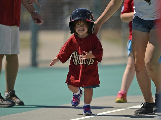 The Diamondbacks' Lily Puzen, 5, runs toward home plate during a game against the Cardinals on Saturday at Resch Miracle Field in Allouez.