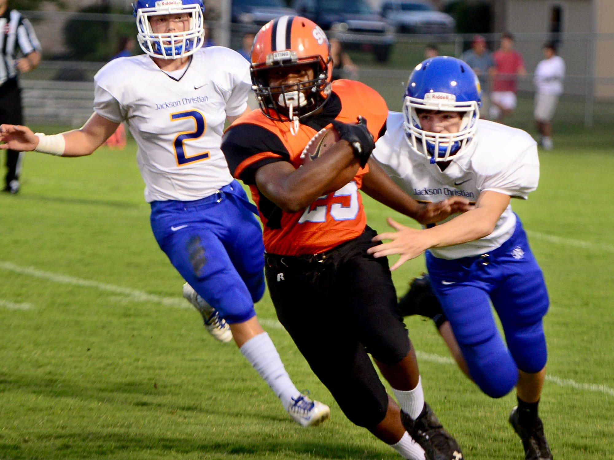 South Gibson County's CJ Sharp outruns Jackson Christians' Collin Cantrell and Hayden Love during their game Friday.