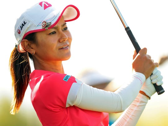 Japan's Ai Miyazato hits an iron off the tee at the 169-yard par 3 eighth hole of the Dinah Shore Tournament Course at Mission Hills Country Club while playing the first round of the ANA Inspiration on Thursday, April 2, 2015 in Rancho Mirage, Calif. Miyazato shot a four-under 68 and is by herself in second place after day one.