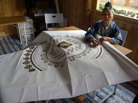 In this Aug. 7, 2016 photo, ethnic minority artisan