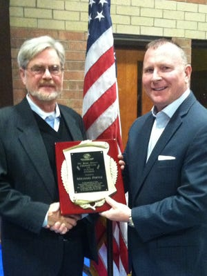 Kelly Rollins, right, awards Mike Pirtle with the Dr. Britt Arnett Champion of Youth Award.