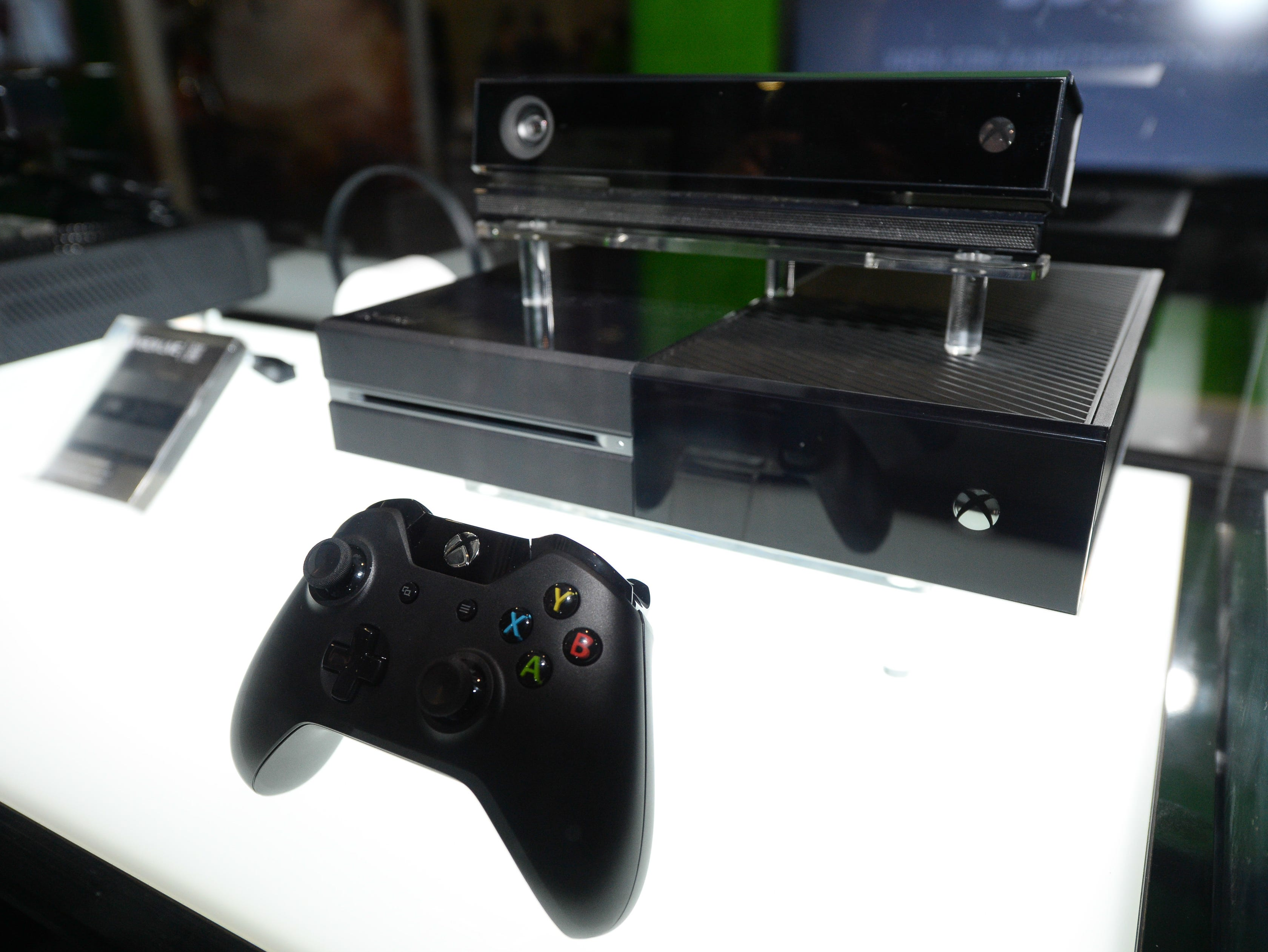 In this Aug. 28, 2013, file photo, the Microsoft Xbox One console is on display at the GameStop Expo in Las Vegas.