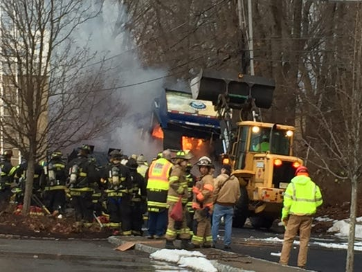 Responders battle a fire at the Mendham Village Shopping